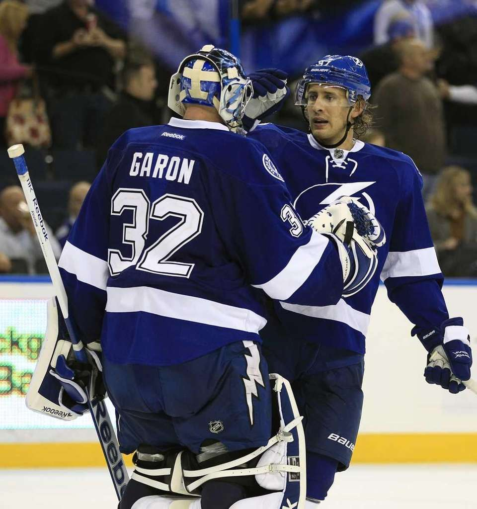 Tampa Bay Lightning goalie Mathieu Garon (32) celebrates