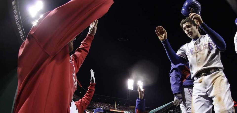 Texas Rangers' Ian Kinsler is congratulated in the