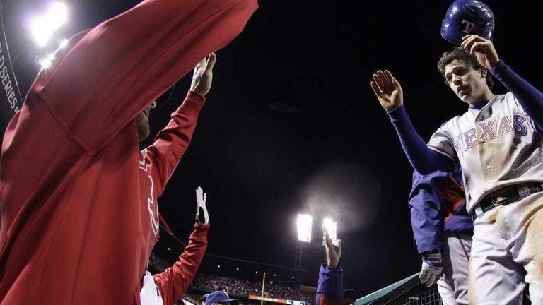 Texas Rangers' Ian Kinsler is congratulated in the