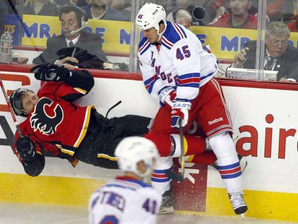 New York Rangers' Kris Newbury, right, sends Calgary