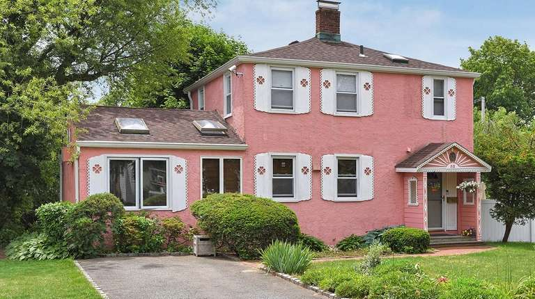 This Roslyn Heights home is listed for $719,000.