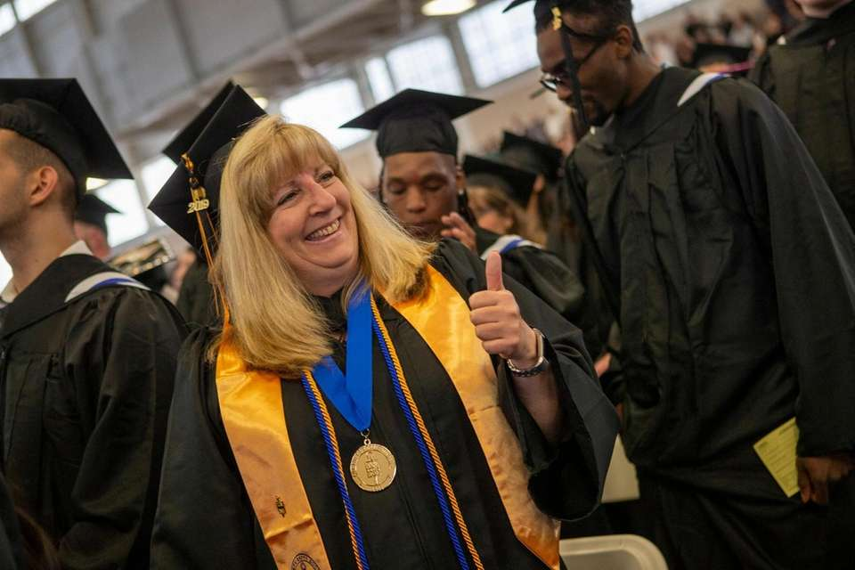 Patricia Kirk, Babylon, marches during commencement at Suffolk
