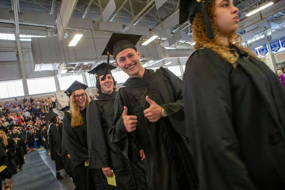 Richard Corcoran, Ridge, marches during commencement at Suffolk