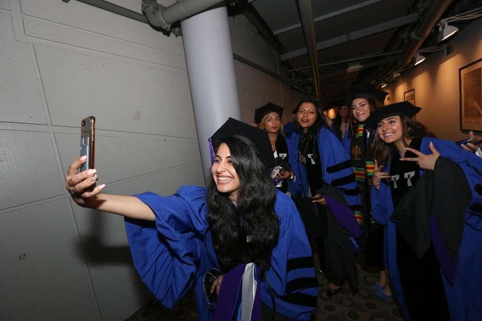 Michelle Kariyeva, of Forest Hills, takes a selfie