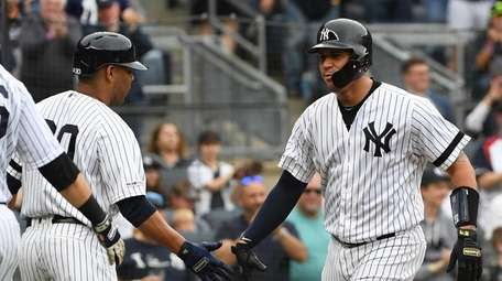 Yankees catcher Gary Sanchez is greeted by Edwin