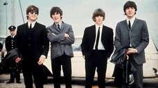 John, George, Ringo and Paul at what was