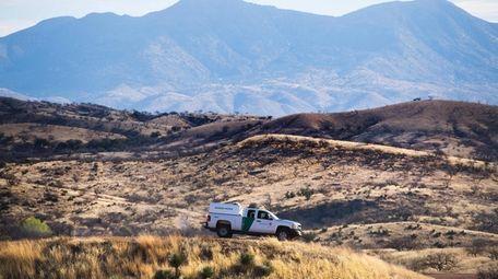A U.S. Border Patrol agent parks near the
