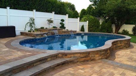 "A semi-aboveground pool known as a ""blue lagoon"""