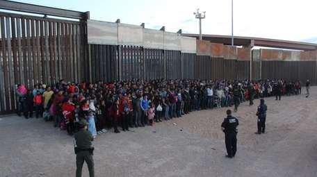 A group of migrants apprehended after crossing the