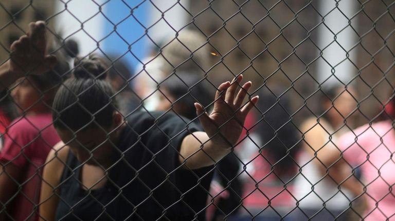 Venezuelan migrants wait at an immigration control point