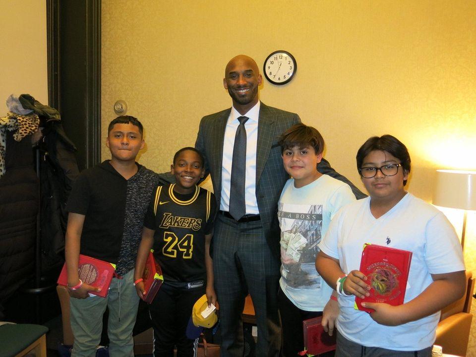 Retired NBA star Kobe Bryant with Kidsday reporters