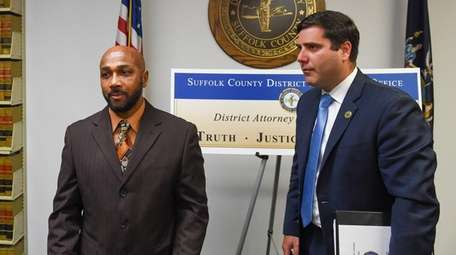 Keith Bush with Suffolk District Attorney Timothy Sini
