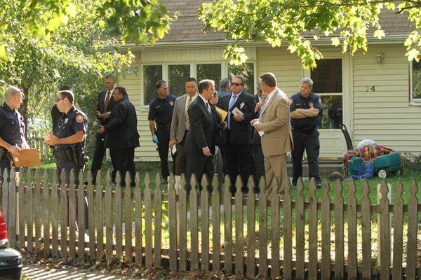 Nassau police investigate the scene outside a Levittown