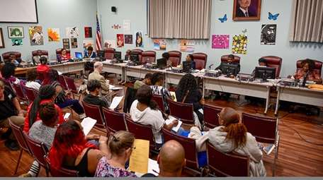 Residents at the Wyandanch school board meeting on