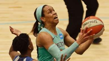 Liberty's Asia Durr drives past Minnesota Lynx's Danielle