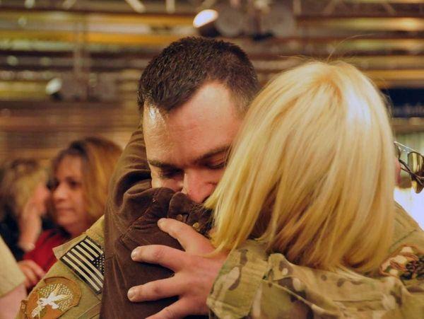 SRA Joseph Occhineri hugs his girlfriend, Dana Kerekes