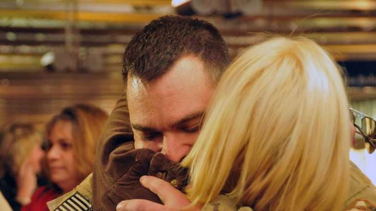 SRA Joseph Occhineri hugs his girlfriend, Dana Kerekes