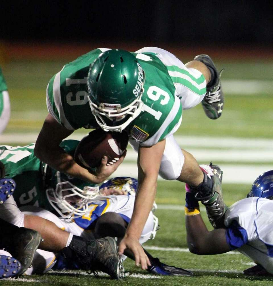 Seaford's Joe Richards dives for extra yards at