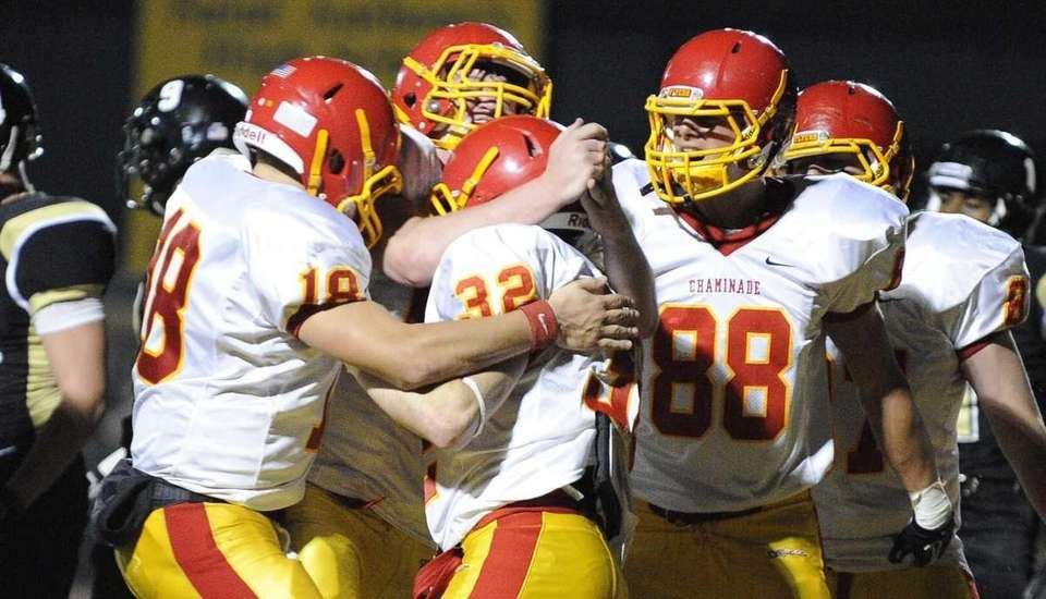 Chaminade teammates congratulate Daniel Fowler, #32, on his