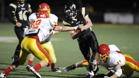 St. Anthony's RB Brian Sherlock breaks tackle attempts