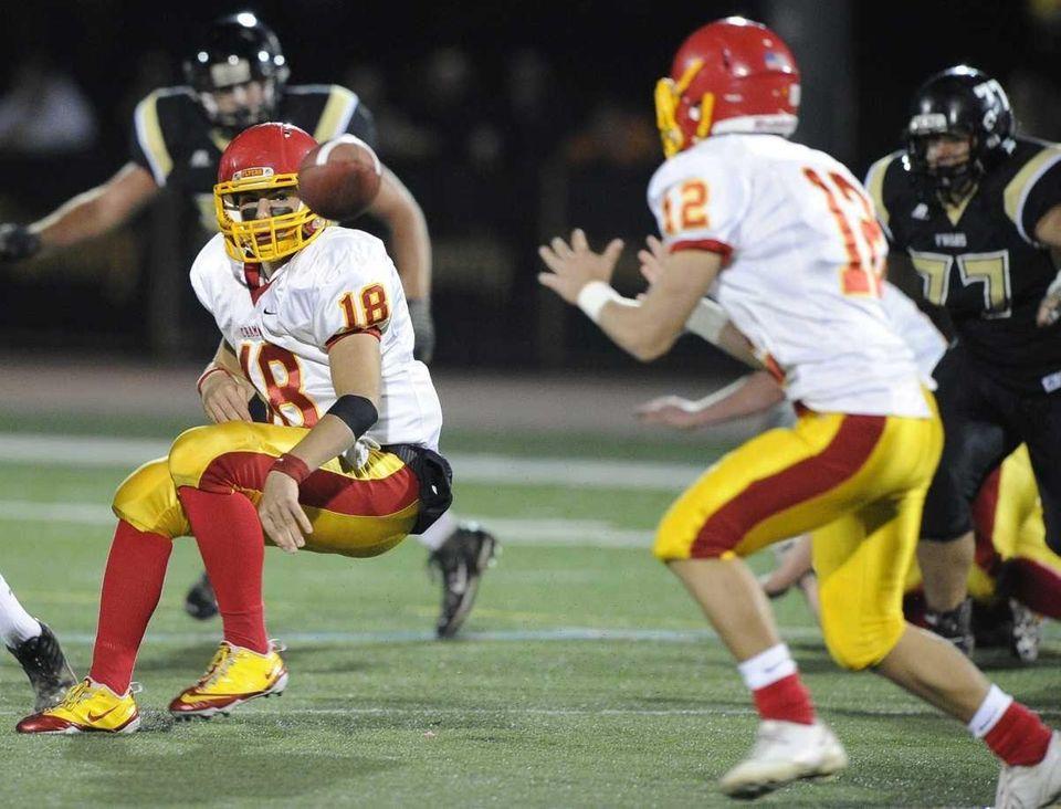 Chaminade quarterback Joseph Anile IV, #18, passes to