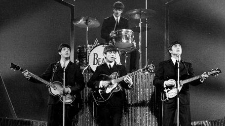 The Beatles on stage at the London Palladium