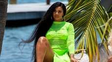 Ashanti models beach wear from her new collaboration,