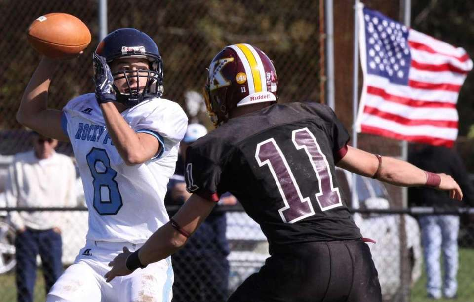 Rocky Point's Quentin Lambert, left, is pressured by
