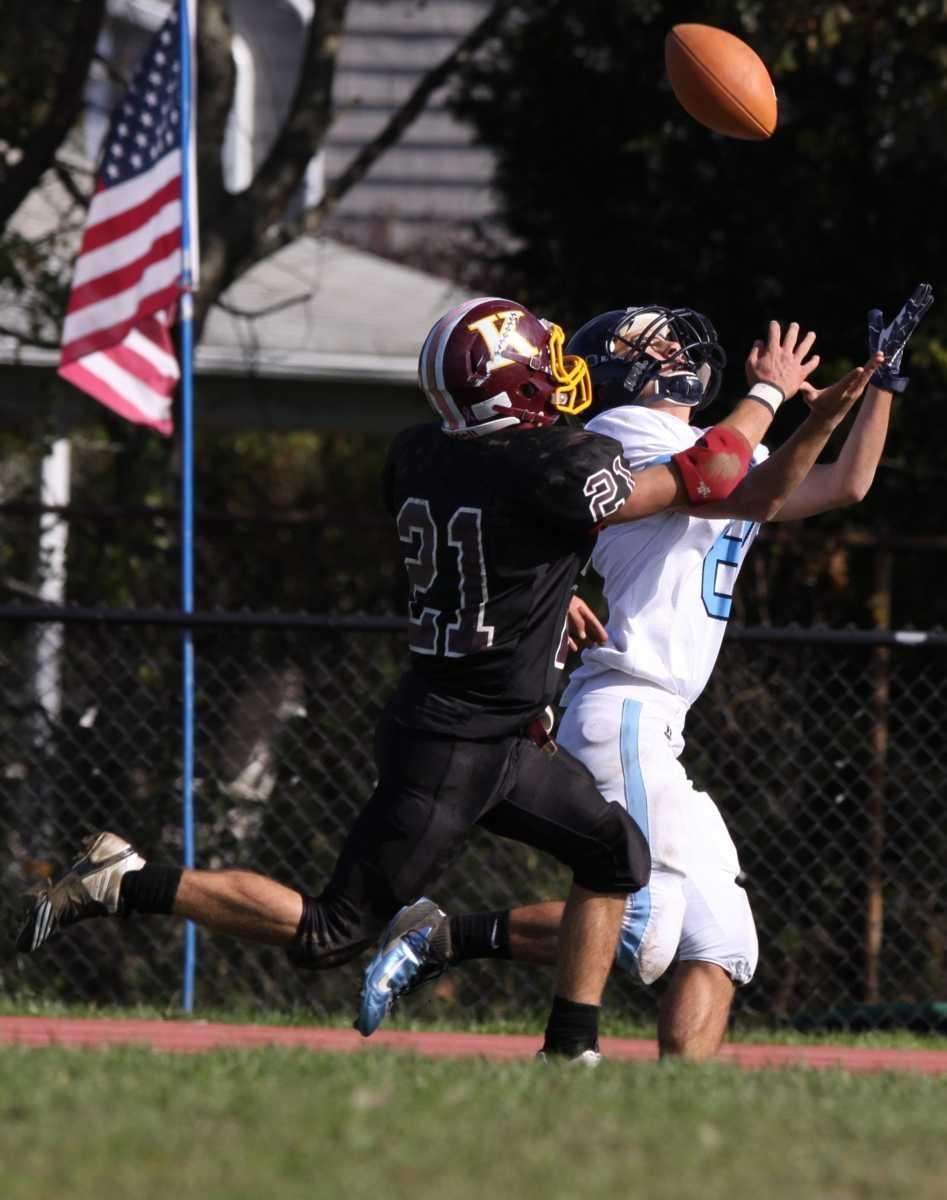 Rocky Point's Quentin Lambert, right, receives a pass