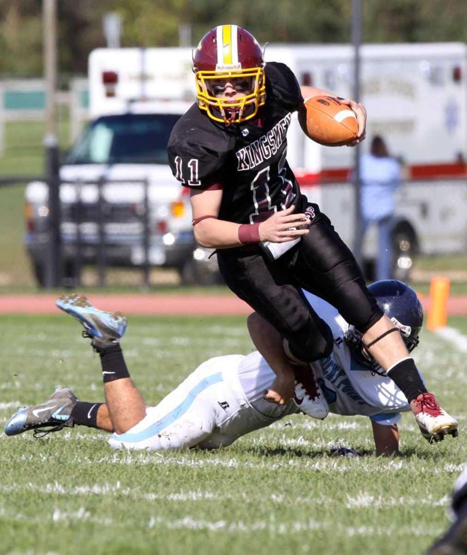 Kings Park's Joey Lynn eludes the tackle of