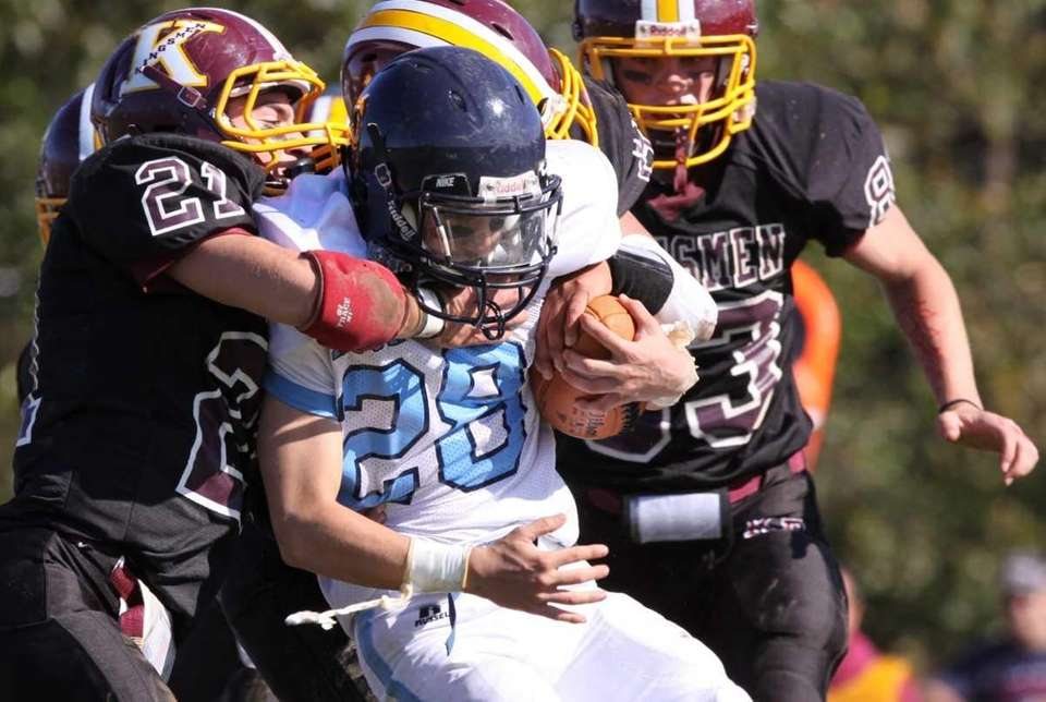 Rocky Point's Joe Kingston, center, is tackled by
