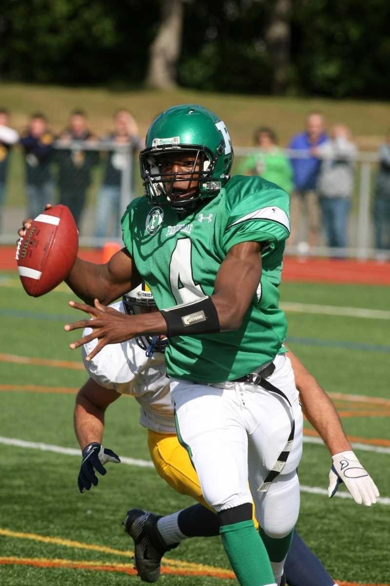 Farmingdale H.S. quarterback Dalique Mingo, no. 4, looks