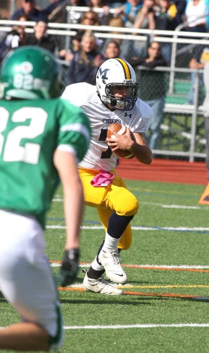Massapequa H.S. quarterback Matt Pagano, no. 7, rushes