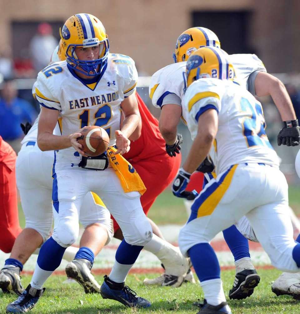 East Meadow QB #12 Dylan Curry looks to