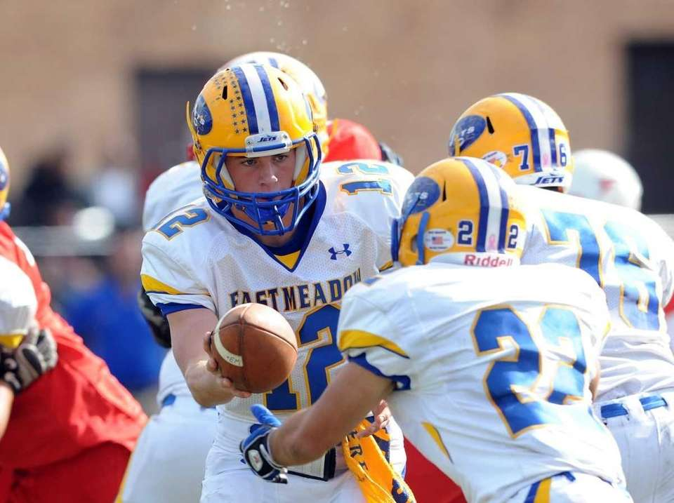 East Meadow QB #12 Dylan Curry hands off