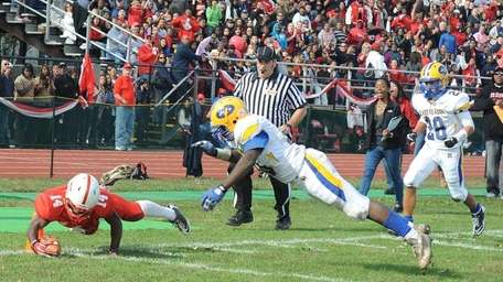Freeport's #14 Maurice Irby dives in for a