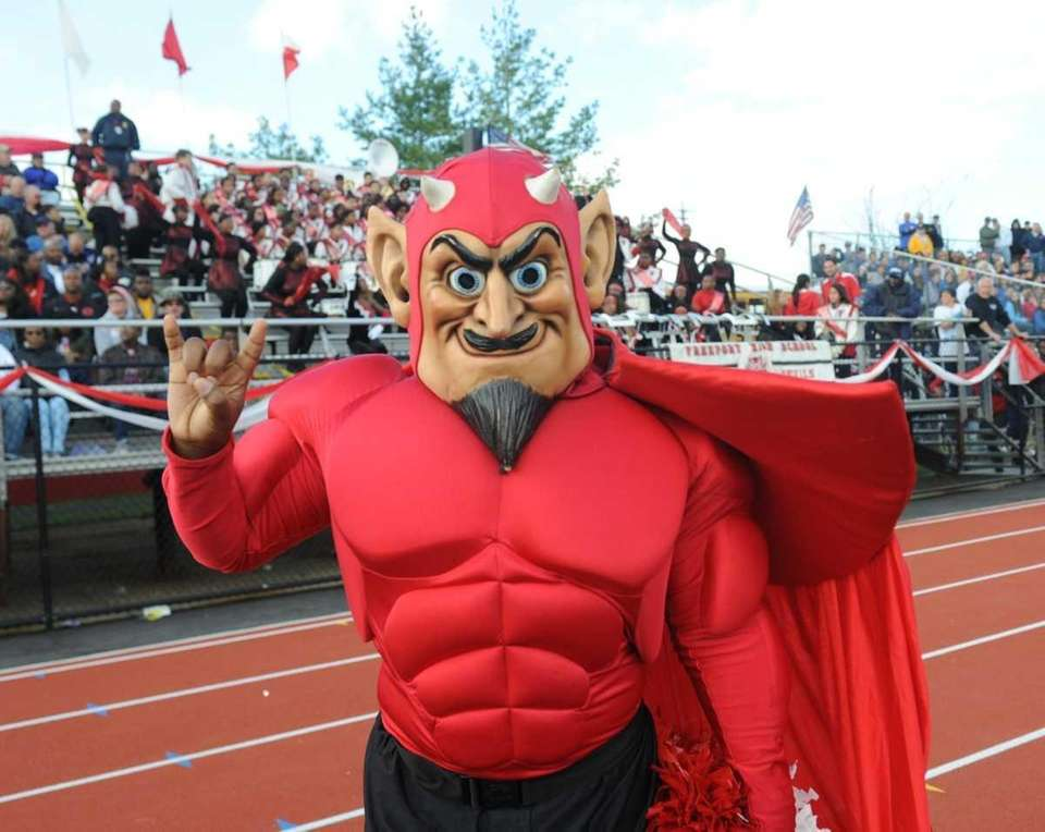 The Freeport Red Devils mascot gives a salute