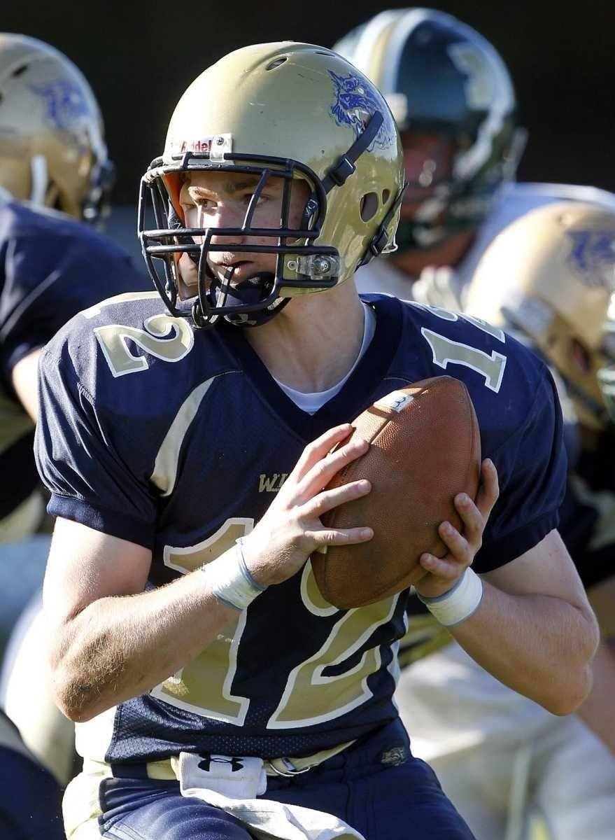 Shoreham quarterback Kevin Kelly (12) looks upfield to