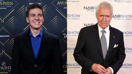 James Holzhauer, left, arrives at the 2019 NHL