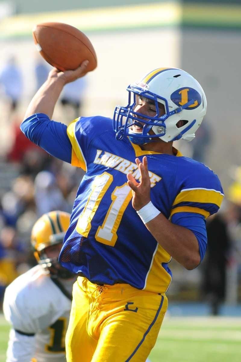 Lawrence High School quarterback #11 Joe Capobianco throws