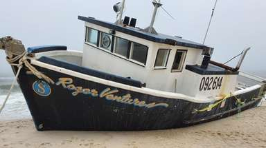 The fishing boat Roger Ventures rests on the