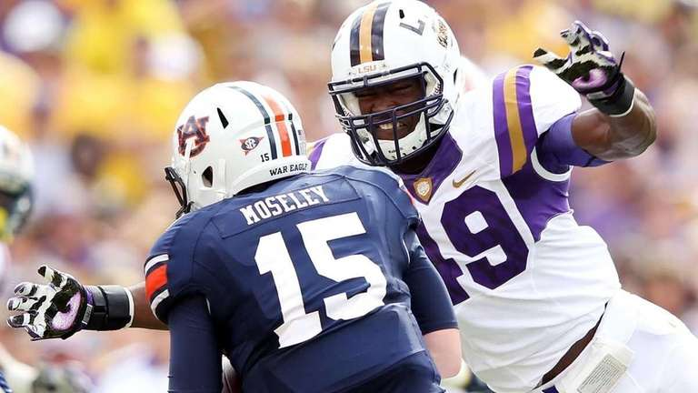 Barkevious Mingo of the LSU Tigers sacks quarterback