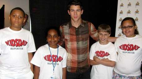 Singer Nick Jonas with Kidsday reporters, from left,