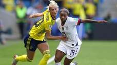 Sofia Jakobsson of Sweden battles for possession with