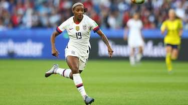 Crystal Dunn of the USA chases down the