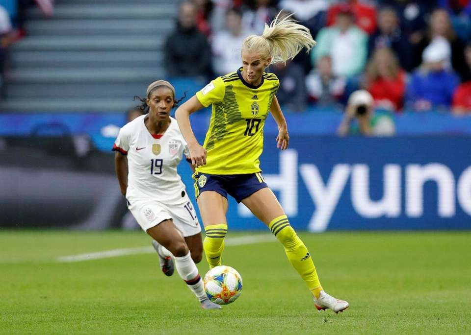 Sweden's Sofia Jakobsson, right, takes the ball away