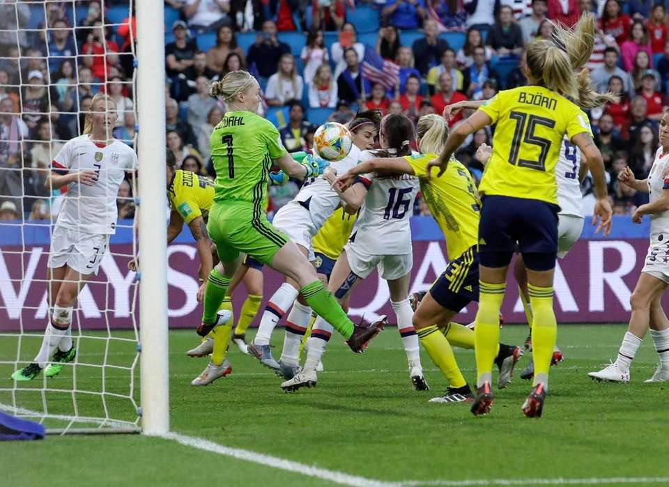 Sweden goalkeeper Hedvig Lindahl clears the ball off