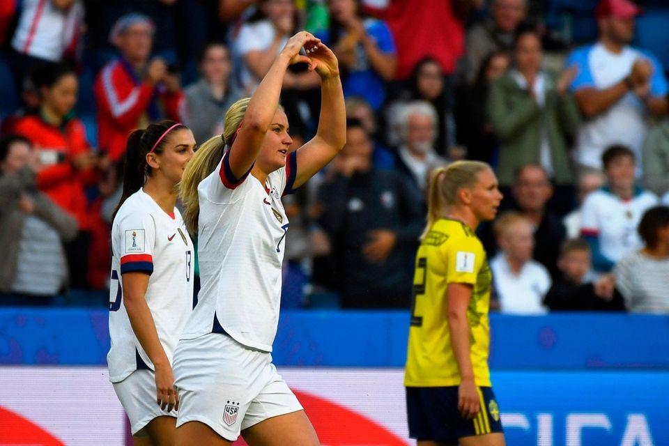 United States' midfielder Lindsey Horan (2L) celebrates after