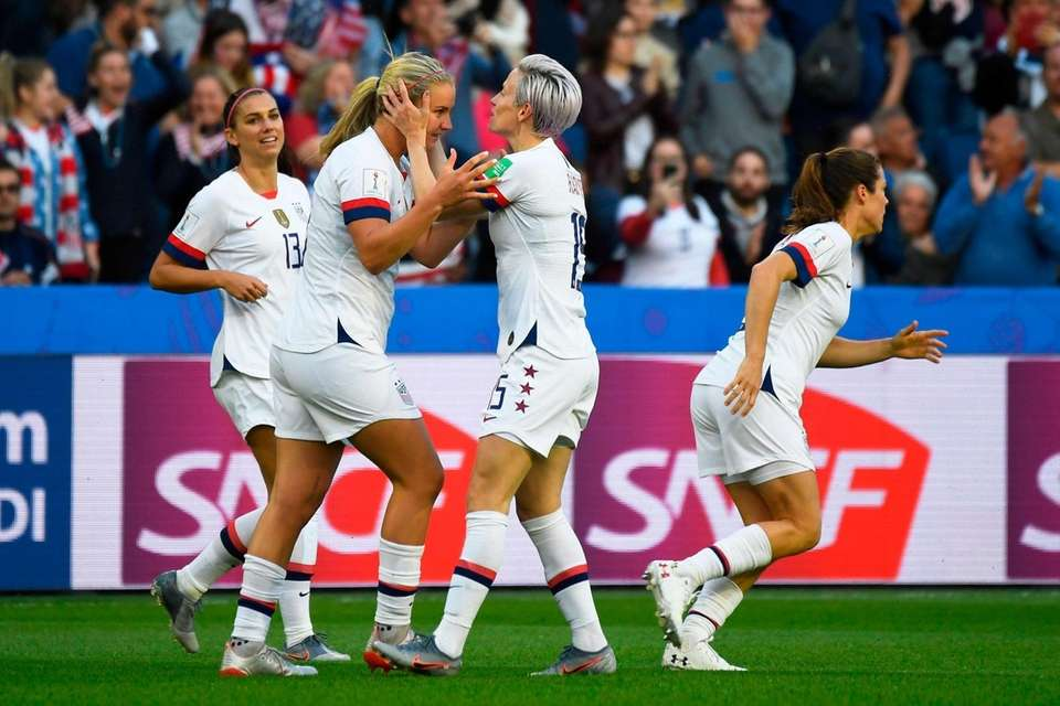 United States' midfielder Lindsey Horan (2L) celebrates with