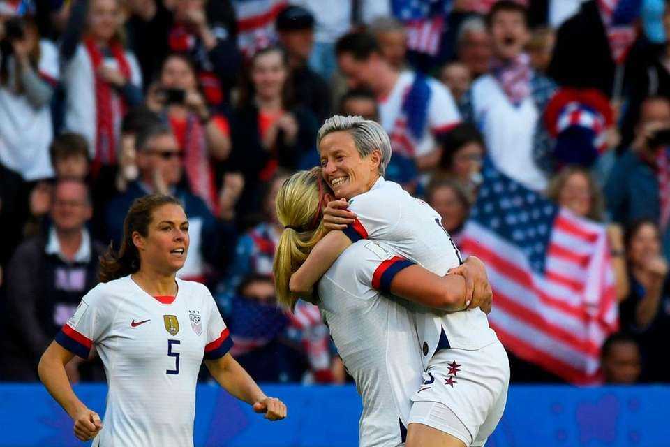 United States' midfielder Lindsey Horan (C) celebrates with